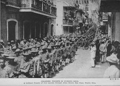 Colored troops in Puerto Rico; A brilliant Fourth of July parade through Allen Street, San Juan, Puerto Rico.