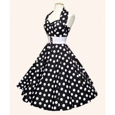 Gorgeous 50's polka dot dress. If I ever were to wear a dress, it'd HAVE to be one like this(: