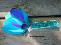Hey, I found this really awesome Etsy listing at http://www.etsy.com/listing/130794952/peacock-garter-bridal-garter-prom-garter