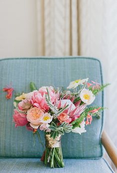 Brides: Pink Bouquet of Coral Charm Peonies and Proteas. Bouquet of coral charm peonies, king proteas, succulents, Icelandic poppies, honeysuckle, ranunculuses, Juliet garden roses, sword ferns, veronica, and tillandsia, $225, Honey and Poppies