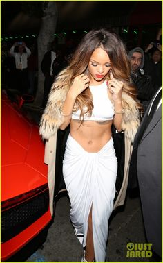 Rihanna snaps at the Island Def Jam 2013 Grammy After Party held at the Osteria Mozza on Sunday (February 10) in Los Angeles.