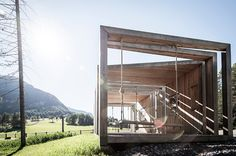 a series of timber frames playing with solid and void forms a multi-functional structure serving as a lookout point, info center, and bus stop for a hotel in northern italy.