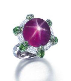 Lot 2048 - A Rare Purple Star Sapphire, Tsavorite Garnet and Diamond Ring, by Wallace Chan