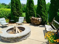 Stacked stone enhances this circular fire pit, with a flagstone top, on a farm in Georgia.