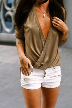 White shorts. Taupe top