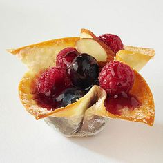 Fill sugar-sprinkled wontons with fresh raspberries and blueberries for a fun twist on this Asian favorite.