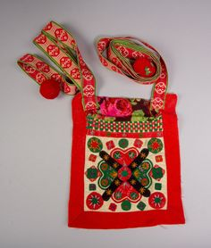 DigitaltMuseum. Swedish traditional bag, part of a woman folkdress. Embroidered.