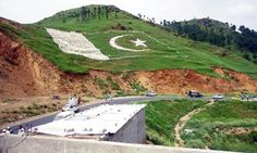 View of Pakistani flag by District Management on a mountain ahead of Independence Day