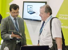Amit Garg interacts with a guest at Learning Technologies 2013.