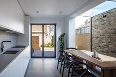 Mulroy Architects has added a glass passageway and angled skylights to this three-storey north London house extension, which features bespoke furniture Home, Home Kitchens, Kitchen Design, Kitchen Inspirations, London House, Pergola Plans Design, House Extension Design, House, House Interior