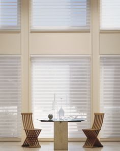 Hunter Douglas Silhouette shades are a great options for this modern dining area.  Call us today and learn more about the $150 rebates! #hunterdouglas #breakfastroom