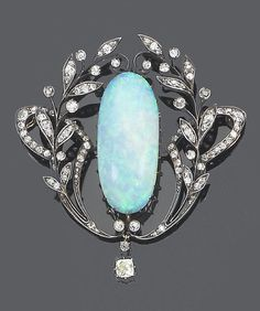 A late 19th century opal and diamond brooch/pendant, circa 1890 The oval cabochon opal within a scrolling single-cut diamond foliate surround, suspending an old brilliant-cut diamond drop, mounted in silver and gold