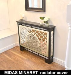 CUBIC BRASS MIRROR radiator cover in satin black WITH MARBLE TOP. The highest quality radiator covers with antique brass laser cut panels for the home or office. Mirror Radiator Cover, Metal Radiator Covers, Radiator Screen, Modern Radiator Cover, Custom Radiator, Radiator Ideas, Radiator Heater, Mirror Decor Living Room, Living Room Decor Cozy