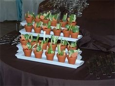 Serve crudites in tiny flower pots - adorable! via Wedding and Party Network