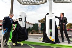 Mayor Matt Hall from the City of Carlsbad and Terry O'Day, Vice President of NRG eVgo California, display the brand new Freedom Station for ...