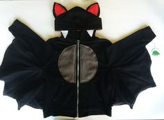 Handmade / original design zip-up bat hoodie for babies and toddlers. Cute for everyday adventures or as a costume! Hoodie is made from a childrens Jumping Beans or Circo Fleece, 60% Cotton, 40% Polyester knit sweatshirt. Bat embellishments are hand designed and sewn using polar fleece.