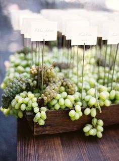 Napa-inspired grape escort cards: http://www.stylemepretty.com/2015/11/16/fall-beaulieu-gardens-wedding/ | Photography: Jose Villa - http://josevilla.com/
