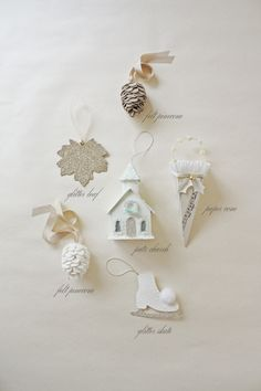 Field Journal made these gorgeous  ornaments for her woodsy Christmas tree. There's a glittered skate, a glittered leaf, a felt acorn, a gorgeous paper cornucopia, and a Putz-style chapel.