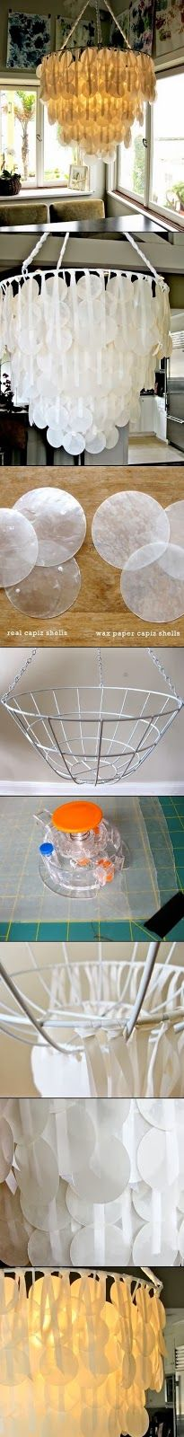 "PAPER CAPIZ SHELL CHANDELIER Materials: - hanging planter basket - white spray paint - ribbon - scissors - 1-2 rolls wax paper - 2 big pieces of parchment paper - iron - hot glue gun & glue sticks - circle cutter (i didn't have any luck with a ""punch"") - cutting mat  http://diyiydidydyiydi.blogspot.co.uk/2013_10_01_archive.html"