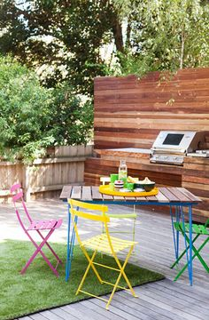 Like the idea of extending the material up the wall, perhaps some outdeco screens that wrap around the side of the BBQ brickwork.