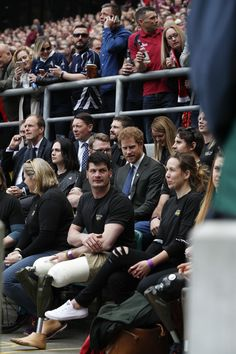 Prince Harry Photos Photos - Britain's Prince Harry (C) takes his seat among competitors from the 2014 and 2016 Invictus Games in the crowd to watch the annual Army Navy armed forces rugby match at Twickenham stadium on April 29, 2017 in London, England. Prince Harry attended the Army Navy match at Twickenham as Patron of the Invictus Games Foundation, which is the Official Charity of the day for this year's match. The Army Navy Match is the annual rugby union match between the senior XV…