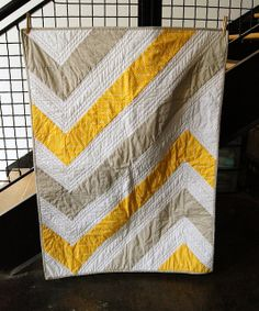 James Baby Quilt Finished by Colbet9980, via Flickr. Similar to another quilt I pinned- love the design/color scheme and top quilting.