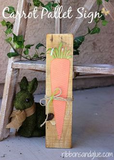 DIY Carrot Pallet Sign. Paper Carrot adhered on to scrap pallet wood. You could make any kinds of vegetables signs with this idea! Perfect for Spring or even kitchen decor.