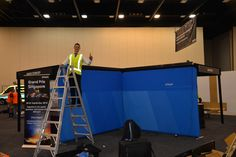 Andrew in action assembling our fantastic Whispir stand at APCO 2013