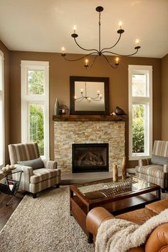 Traditional Living Room with Veneerstone imperial stack stone vorago flats, Hardwood floors, Chandelier, stone fireplace