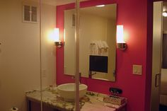 Flamingo, Las Vegas, Nevada -- Mainly pinning for the pink accent recessed TV mirror. But there's also another photo in the source where it shows different colored lighting in there.