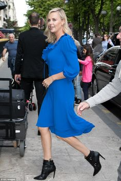 Ruffle it up in Charlize's blue Balenciaga dress #DailyMail