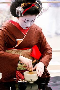 Maiko performing tea ceremony at Plum blossom festival in Japan