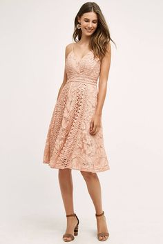 For a simple and romantic boho look, go with lace bridesmaid dresses in shades of blush, sage, or sky blue. This pretty frock can be worn on many summer nights ahead.