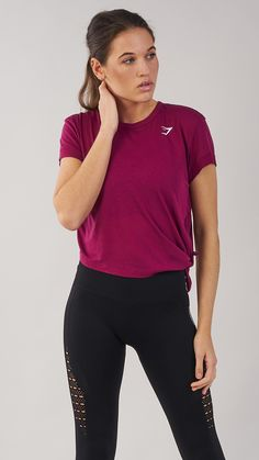 The Essential Tee offers a loose, comfortable fit, allowing you to move freely through your workout. Coming soon in Deep Plum.