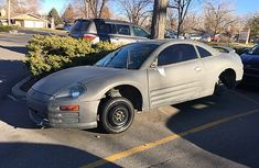 Someone abandoned a car at King Soopers and all of the wheels have been removed. The spare tire was put on the left front side. The back of the car is up on blocks. King Soopers, Fort Collins, Parking Lot, Abandoned, Wheels, Car, Left Out, Automobile, Parking Space