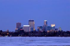 Blue view by Henrik Nordstrom on Capture Minnesota // A windswept view of downtown from Lake Calhoun as the cold winter sun fades to blue