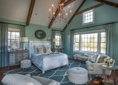 New HGTV 2015 Dream House with Designer Sources This stunning master bedroom combines neutrals with calming shades of blue as a nod to the soft coastal style found in the Cape Cod home. The queen bed combines white with soft blue for a gentle calming effect. The upholstered headboard with a nail-head trim is a luxurious addition that frames the bed and exudes a soft, cozy vibe.