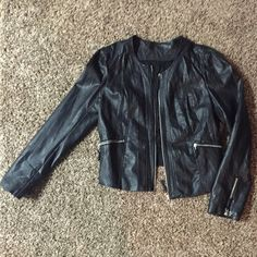 BKE faux leather jacket with lace back Tags are not on it but it has never been worn. Beautiful lace back. It is a Large, but it fits me and I usually wear a medium! BKE Jackets & Coats