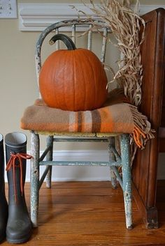pumpkin and blanket on chair...corner of the kitchen in the fall...........