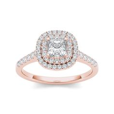 Make your loved one feel like a princess with this delicately elegant rose gold engagement ring. Its 14-karat rose gold band softens the strong lines of the white diamonds on the ring. The princess-cu