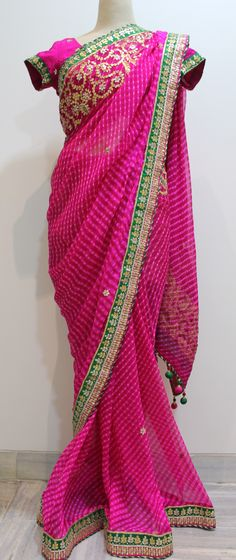 Fuchsia Pink pure chiffon Lehariya saree with Gota patti work. It comes with a fushcia pink pure crepe unstitched blouse with gota work all over. To buy this saree please leave a message or email me at stylesandpatterns@gmail.com