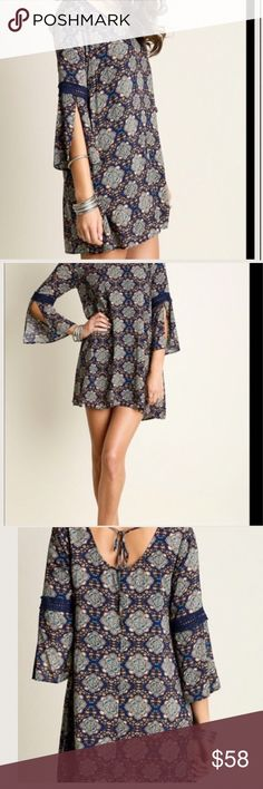 """Paisley Print Shift Tunic Sizing: Size S: Bust 35-36"""" Waist 27-28"""" Hips 36-37"""" Size M: Bust 37-38"""" Waist 29-30"""" Hips 38-39"""" Size L: Bust 39-40"""" Waist 31-32"""" Hips 40-41"""" Bell Sleeved Quatrefoil Print Dress Sleeve slits under embroidered sleeve band Shift style Tunic Dress Amazing in comfort, flattering fit, loose boho style!  Color is Navy Visit us at our Facebook Shop! https://www.facebook.com/BohoLocoFashionBoutique/ Visit us on Poshmark! https://poshmark.com/closet/fashionboholoco Paisley…"""