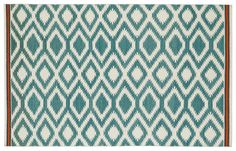 Contemporary trends meet Southwestern style in this handmade wool rug. Each rug is inspired by classic design motifs, and flat-woven using only the finest pure wool. A rug pad is recommended to...