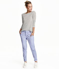 Chinos in washed stretch cotton fabric. Side pockets, welt back pockets with button, and slim, tapered legs.