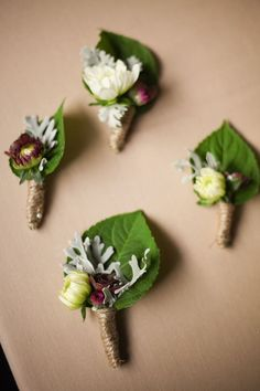 Mini boutonnieres with tiny flowers wrapped in twine | Ashley Wexler Photography