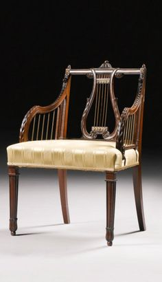 A pair of George III gilt-lacquered brass-mounted mahogany armchairs circa 1770, attributed to John Linnell
