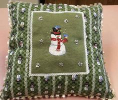 Snowman and bird machine embroidery design pillow.