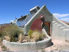 Earthship - off grid, solar, grey water, etc. Comfort in any climate. Built using tires and rammed earth tech. bottles or cans for the interior walls. Amazing, healthy, soulful.