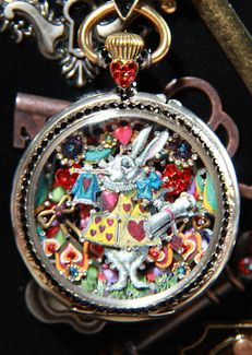 Great Alice in Wonderland Themed Pocket Watch made by artist Tracey Davis. All her jewelry is done with antique pocket watches and other little treasures.