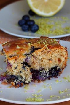 "Lemon Yogurt Cake with Blueberries | ""This is a light and fresh lemon cake flavored by fresh lemon zest and lemon yogurt. To top it off, fresh (or frozen-- whatever is on hand!) blueberries are added to the middle and top of the cake."" #cakerecipes #bakingrecipes #dessertrecipes #cakes #cakeideas"